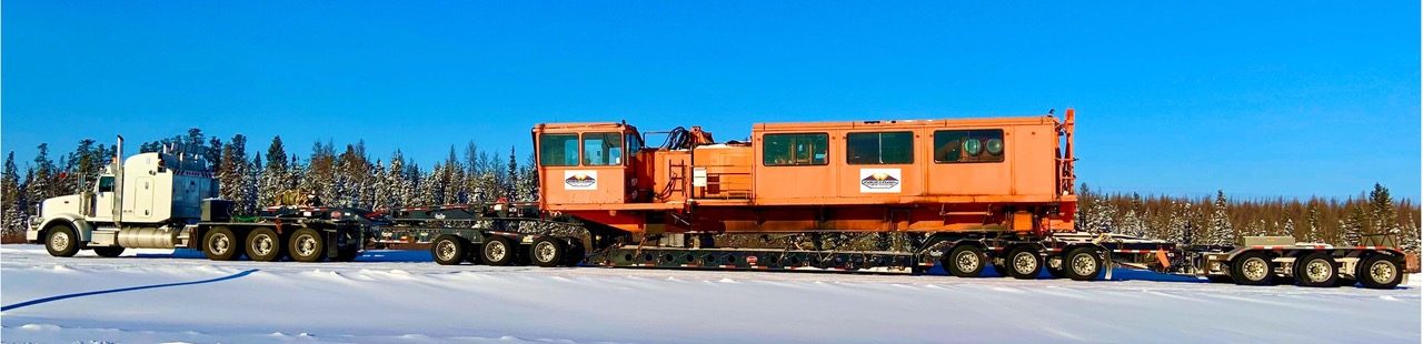 Heavy equipment haulers for drilling and blasting
